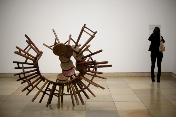 the-art-installation-20-chairs-from-the-qing-dynasty-by-ai-weiwei-one-of-chinas-most-controversial-artists-is-pictured-at-haus-der-kunst-on-october-9-2009-in-munich-germany-the-show-so-sorry-will-ope